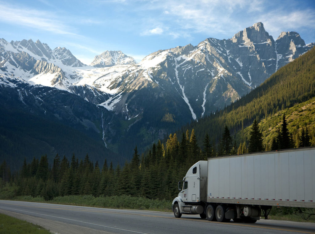truck heading to the snow covered mountains